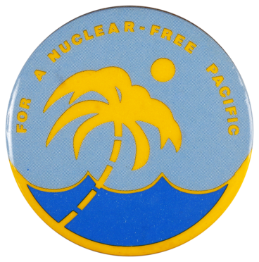 This badge was worn in support of the Nuclear Free Pacific campaign of the early 1970s which protested against French nuclear testing in French Polynesia. A total of 200 nuclear tests were conducted by the French military in the Pacific region between 1966 and 1996.